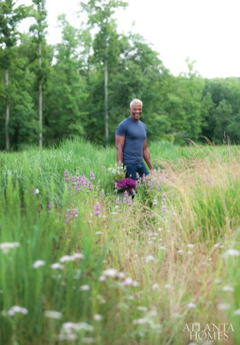 Floral/event/garden designer Keith Robinson forages for wildflowers in a meadow near his home.