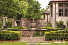 Climbing ivy, a labyrinth of manicured hedges and a trickling fountain make up this serene spot situated outside the master bedroom.