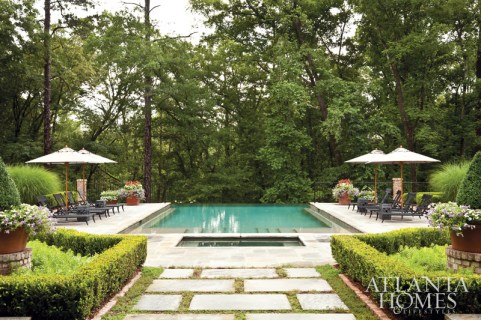 Instead of maximizing the lot with the house's footprint, landscape architect John Howard used the extra space to accommodate a pool, terrace and secret gardens.
