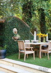 """""""We love to open up the doors and have our parties blend outside,"""" says Debra, who often hosts al fresco affairs in the ivy-clad back yard."""