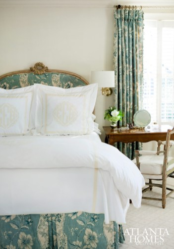 The master bedroom is cloaked in Colefax And Fowler fabric; monogrammed Leontine Linens dress the bed.