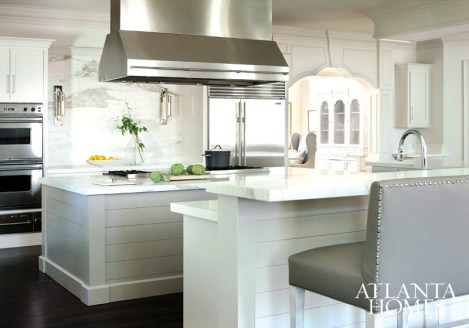 """Hammersmith and Broaddus refaced the kitchen cabinetry and replaced upper cabinets with a wall of Calcutta Caldia marble. """"It really sets the stage for the space,"""" says Broaddus."""