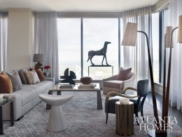 A Vladimir Kagan floor lamp and a whimsical, dipped stool from Pieces are balanced by a linen Christian Liaigre sofa.