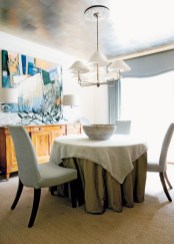 The dining room ceiling was treated with silverleafed Chinese tea paper, adding instant glamour. Table skirt and chair fabric, Larsen, Travis and Co. Fabric overlay, Rogers & Goffigon Ltd., (212) 888-3242. Sideboard, The Stalls at Bennett Street, (404) 352-4430. Painting, Will Kay, Carter Kay Interiors, (404) 261-8119. Bowl, South of Market, (404) 995-9399. Chandelier, Niermann Weeks, Grizzel and Mann, ADAC, (404) 261-5932.