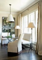 The family dining room creatively mixes contemporary and antique pieces. An antique metal folding table from a Paris flea market is flanked by a Lido bench, Ainsworth-Noah (404) 231-8787, in Old World Weavers white-on-white fabric, Jerry Pair, (404) 261-6337. Framed botanicals and Carter chairs, South of the Market.