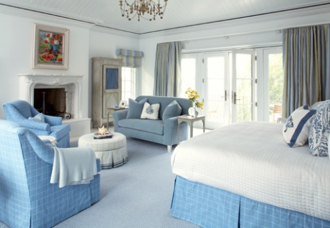 The master suite, with a balcony overlooking the marsh below, is removed enough from the action of the house to make it a private sanctuary. Jennifer Orne designed the fireplace with Chesneys of London inlaid with a mosaic tile border.