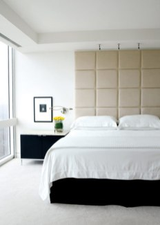 In the master suite, the bed's custom headboard lends a soft yet graphic element to the space.