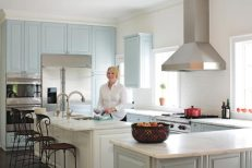 """In the newly expanded kitchen, which Lu Worrell worked on with kitchen designer Cynthia Zeigler and architect Walker Candler, she now has plenty of room in which to hone her culinary skills. """"I didn""""t want my kitchen to look like anyone else""""s,"""" says Lu. With pale blue cabinetry featured predominantly, she got her wish""""and her favorite color, too."""
