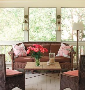 """Lu""""s casually elegant screened porch serves as a second living room during summer months."""