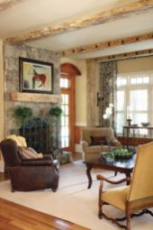Reclaimed wood beams set a relaxed tone for the family room, rendering it both elegant and liveable at once.