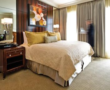"With expansive 9""6"" ceiling heights, guest rooms at The Mansion on Peachtree feature furnishings with a high level of detail, including lush velvet and satin fabrics. Bathrooms feature marble-top vanities, dual washbasins, a deep-soak tub, walk-in marble shower and wall-mounted LCD TV."