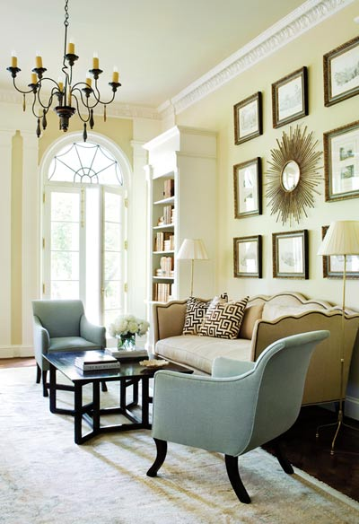 """Built-in bookshelves were added by Kasler""""s team to enhance the existing architecture, designed collectively by William Frank McCall, Keith Summerour and William H. Harrison. A collection of antique watercolors forms a strong focal point in tandem with one of Kasler""""s trademark sunburst mirrors."""