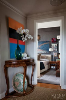 The hallway features a rustic Chinese demilune from Mimi Williams Interiors and a contemporary painting from Lost Art Salon, a San Francisco gallery.