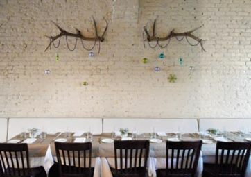 The communal table at Shaun's Restaurant in Inman Park is set and ready to welcome the holidays.