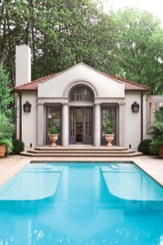 The easy transition between pool and pool house can be credited, in large part, to common elements, such as limestone surfaces and quiet neutral hues used both indoors and out.