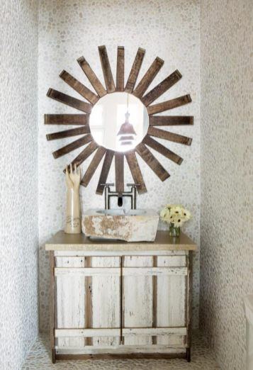The designer's singular point of view is, in fact, evident throughout the house, right down to the powder room mirror made of wine barrel staves and the sculptural Don Quixote greeting visitors at the front door.