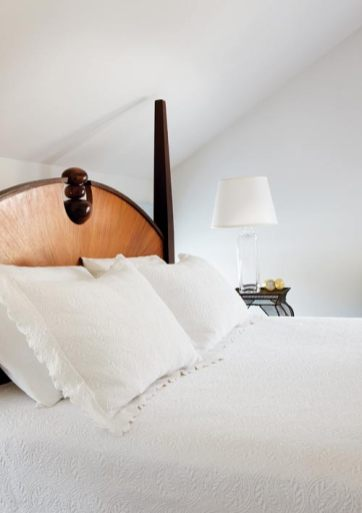 """In the master bedroom, the couple""""s custom veneered bed was a gift to each other for their wedding in 1998."""