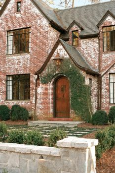 """Douglass was immediately attracted to what she refers to as this Tudor's crunchy exterior. Part of its beauty is that its not perfect,"""" she says. Someone painted it in the past and didn't want to clean up. To her, it's all part of the charm."""