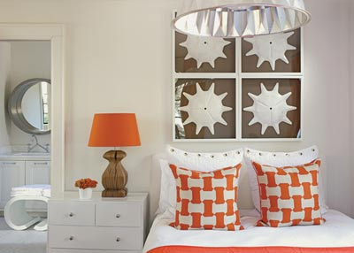 """Cheerful shapes and touches of tangerine add individuality to Douglass"""" son""""s room, without being cutesy or cliche."""