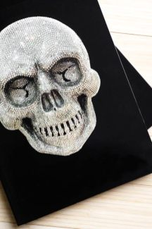 A catalog of the artist's work features one of her skull designs on its cover.