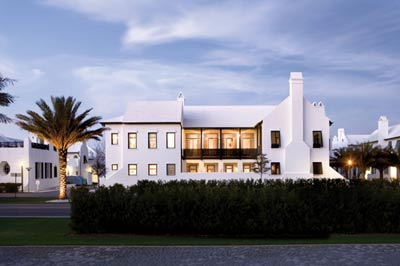 """Because Musso and Cooke were two of the first homeowners in Alys Beach, they""""ve seen many waves of change in the coastal community. """"It""""s a great time to be here,"""" says Musso. """"Every time we go, we see something new."""" Because the two frequently make the trek to Alys Beach at the end of a long work day, they often don""""t arrive until after 10 p.m. Still, the living room frames a beautiful view, no matter what the hour may be. """"I actually think the house looks prettier at night,"""" says Musso. """"That""""s my favorite time of day to be there, because when the moon is full and reflecting off the water, it""""s really magical."""""""