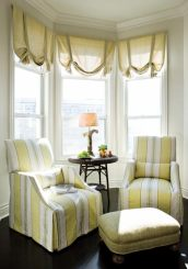 This sunny spot, made even more so by a pair of yellow-and-white striped chairs designed by Bobby McAlpine for Lee, provides a cozy, comfy breakfast area.