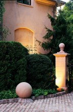 Jeremy Smearman's selections for the landscape included a wide range of coniferous plants suitable to the local climate. Landscape lighting through The Outdoor Lights.