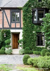 In just one example of this home's grand, yet unfussy, landscape design, Graham Pittman trained ivy to grow over the home's facade for an authentic English look.