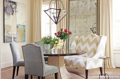 """The dining room has a collected-over-time look, with just the right amount of whimsy thrown in. """"It's all very classic, but then it puts a smile on your face when you see something like that settee,"""" says Howard."""