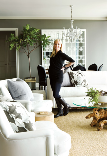 """Pieces owner Lee Kleinhelter, at 34 weeks pregnant, stands in her recently-feathered nest. After moving in, she became smitten with Sovereign""""s amenities, especially the concierge service. """"It""""s something people in New York and other cities are used to, but in Atlanta it""""s a luxury,"""" she says."""