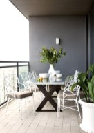 The terrace provides eye-catching views of the city skyline, its vintage trellis garden chairs adding pop and pattern.