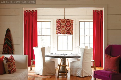 """The dining room in Kay Douglass"""" Lake Rabun vacation house features felt curtain fabric by Pollack""""s Vilano, available through Donghia. Table, chairs and stools, South of Market."""