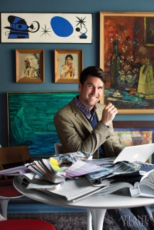 Interior designer Brian Patrick Flynn at work in his Hollywood Hills home. One office features open storage with ebony-stained bookshelves.