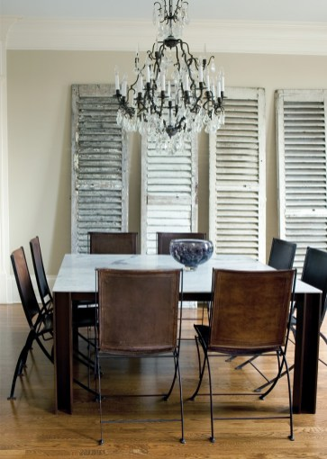 19) Rough-hewn shutters effortlessly meld with a crystal chandelier and leather folding chairs in this dining room by Susan Sing
