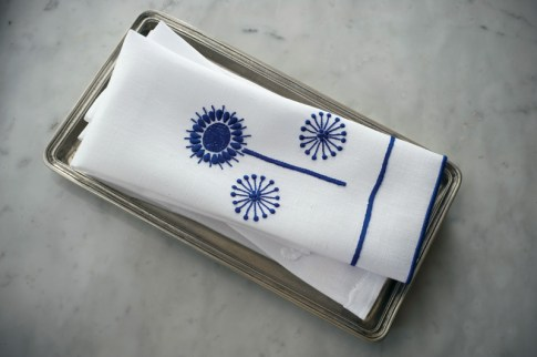 """""""New flower"""" embroidered blue-and-white fingertip towels, $48 each. Available through Sharyn Blond Linens, (913) 362-4420; sharynblondlinens.com"""