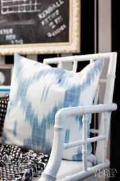 """To add style and comfort to Killmond""""s office, Flynn incorporated a white Chinese Chippendale chair from Wisteria along with a custom lumbar pillow made from a blue-and-white Kravet print."""