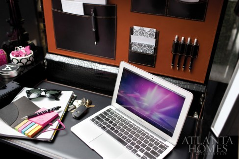 In the office of associate Noelle Keshishian, Flynn used a black lacquer desk with a flip-up top, which not only adds privacy from the front, but also reveals an interior covered in crocodile with Hermes orange upholstery and storage pockets for desk items.