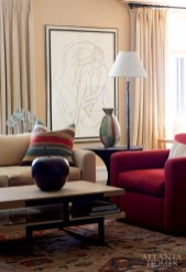 The space also features a serigraph by Matisse from Raphael Fine Art in New York. J. Robert Scott's Sonoma club chair is upholstered in Cowtan & Tout's Penrose fabric. The copper apple sculpture is from Baker, Knapp & Tubbs. Bronze-and-limestone coffee table, Jerry Pair & Associates. Rug, Rugs by Robinson.