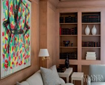 Maple-glazed paneling envelopes the master suite's sitting room. Green Rain, a woodcut and intaglio work on paper, is by Jim Dine.