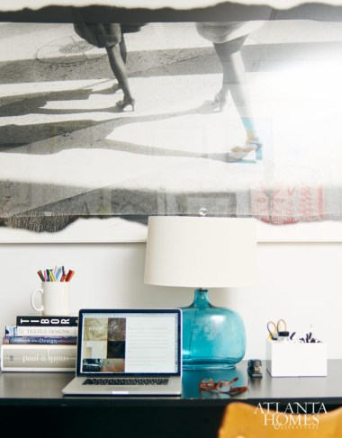 A site mock-up for Francois & Co. on his laptop and an office wall.
