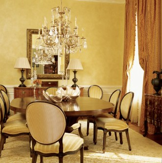 """65) The curry color of this dining room by Douglas Weiss allows the room to """"glow"""" during candlelit dinners."""
