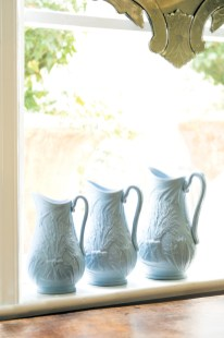 Light blue Antique English Drabware pitchers, $395 for a set of three. Available at Boxwoods Gardens & Gifts