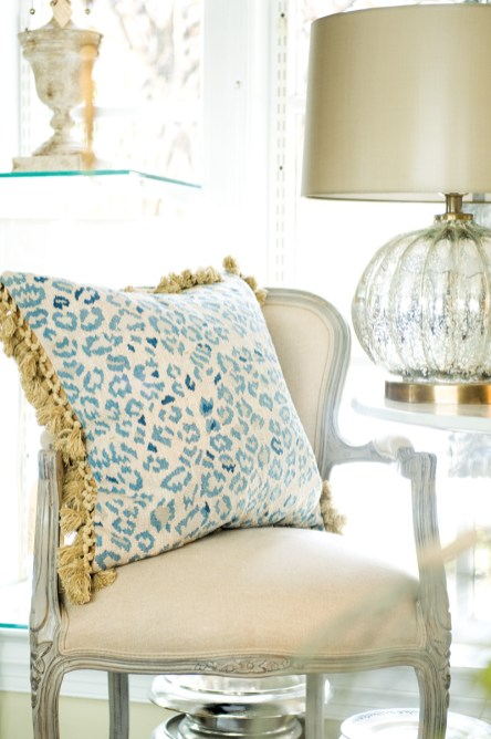 Blue-on-creme leopard-print Aubusson pillow with gold tassel trim, $525. Available at Boxwoods Gardens & Gifts