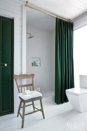 A mix of high and low price points allows you to feel indulgent- without breaking the bank. In the shower, Porcelanosa wall tile and Ann Sacks floor tiles are both listed at less than $15 per square foot. Shower fixtures from Delta.