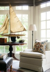 In Tom Pearce's office, a model ship stands proudly in the bay window and reflects the family's shared passion for boating.
