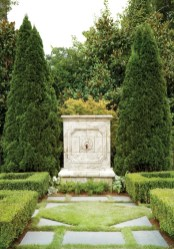 The garden includes a combination of formal and informal spaces, as well as a fountain and a fire pit.