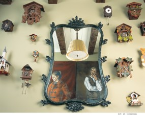 81) For this hallway, Paula and Glenn Wallace deftly mixed cuckoo clocks with works of art by SCAD students.