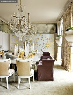 "All That Glitters Dining Room, Melanie Turner The dining room featured the sparkle and shimmer of silver and gold, alongside crystal and porcelain""all reflected in antiqued mirror. A polyptych painting by Tom Swanston anchored the voluminous, light-filled space."