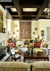 "Soft Spot Family Room, Patricia McLean An expansive family room was divided into distinctive sitting areas for relaxing and working, as well as entertaining two or 20. A large tapestry incorporated all of the room""s hues, from the sunny paint color to the Jim Thompson fabrics used on furniture, curtains and even some lampshades."
