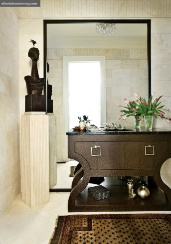 Soft Curves Powder Room, Cheryl Lucas & Jackie Cottrill A sculptural vanity added a sensuous verve to the petite stone-clad powder room.